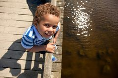 Little Boy on a Wooden Bridge Royalty Free Stock Images