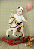 Little boy on wooden horse royalty free illustration