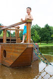 Little boy on a wooden ship Royalty Free Stock Images