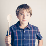 Little boy with wooden spoon ready to cook Royalty Free Stock Photo