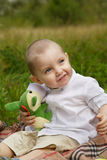 Little boy in the woods. Little smiling boy in white shirt in the woods Stock Photos