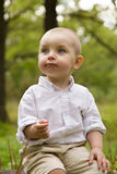Little boy in the woods. Little smiling boy in white shirt in the woods Royalty Free Stock Image