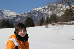 Little boy with wool cap and winter jacket in the mountains Stock Photo