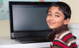 Little Boy Working On a Computer. At His Desk Royalty Free Stock Photo