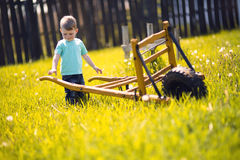 Little boy working in the fields Stock Images