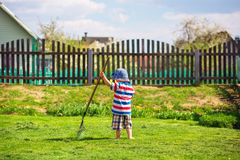 Little boy working in the garden. Royalty Free Stock Photography