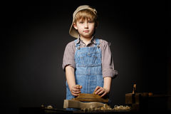 Little boy working with plane Stock Image