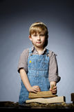 Little boy working with plane Royalty Free Stock Photography