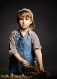 Little boy working with plane Royalty Free Stock Images