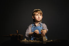 Little boy working with plane Stock Photos
