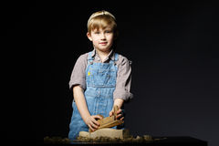 Little boy working with plane Stock Images