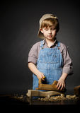 Little boy working with plane Stock Photo