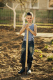 Little boy working with shovel in garden Stock Photo