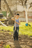 Little boy working with shovel in garden Stock Image