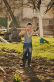 Little boy working with shovel in garden Royalty Free Stock Photo