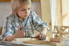 Little boy  working with wood Royalty Free Stock Photography