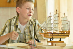 Little boy  working with wood Royalty Free Stock Photos