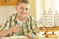 Little boy  working with wood Royalty Free Stock Images