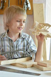 Little boy  working with wood Stock Photos