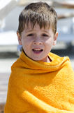 Little boy wrapped in towel Stock Photos