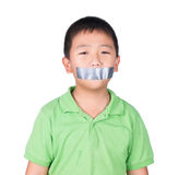 Little boy with wrapping adhesive tape around mouth, rights of a child, isolated on white background Royalty Free Stock Image