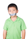 Little boy with wrapping adhesive tape around mouth, rights of a child, isolated on white background Stock Images
