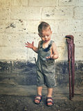 Little boy with a wrench standing at the wall Royalty Free Stock Photo