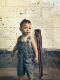Little boy with a wrench standing at the wall Royalty Free Stock Images