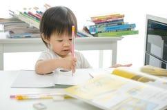 Little boy is writing Stock Image