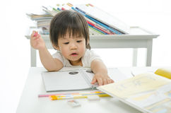 Little boy is writing Royalty Free Stock Image