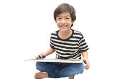 Little boy writing blackboard with smile on whoite blackground Stock Photos