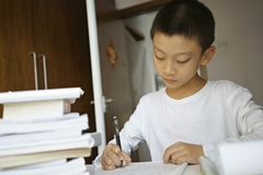 Little boy writing Royalty Free Stock Image