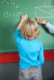 Little Boy Writing Formula On Greenboard Stock Photos