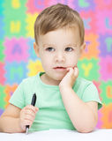 Little boy is writing on his copybook Royalty Free Stock Images