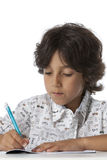 Little boy is writing in his exercise book Stock Photos