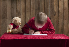 Little boy writing a letter for Santa Royalty Free Stock Photography
