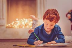 Little boy writing a letter to Santa Clause stock photos