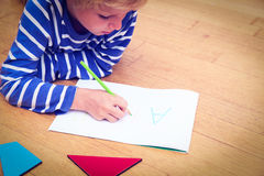 Little boy writing letters, early education. Concept stock photo