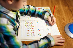 Little boy writing math homework Royalty Free Stock Images