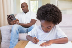 A little boy writing on notepad Royalty Free Stock Photo
