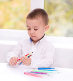 Little boy is writing using a pen Royalty Free Stock Photo