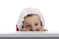 Little boy with xmas hat Royalty Free Stock Image