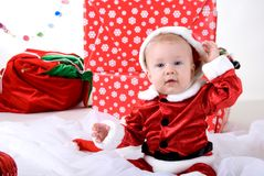 Little boy in xmas outfit. With presents and gifts stock photo