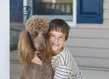 Little Boy y perro Foto de archivo