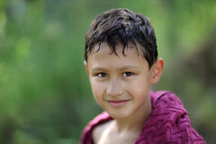 Little boy 10 years old against green grass colors Royalty Free Stock Image