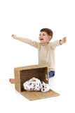 Little boy yelling happily at dog Royalty Free Stock Images