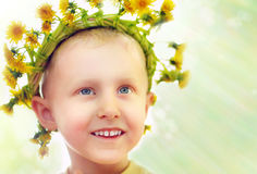 Little boy in yellow dandelios wrearh Royalty Free Stock Photography
