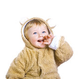 A little boy in a yellow fur suit Royalty Free Stock Images