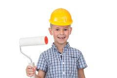 Little boy in yellow helmet and checkered shirt playing a painter. Different occupations. Isolated over white. Royalty Free Stock Photography
