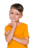 Little boy in the yellow shirt Stock Images